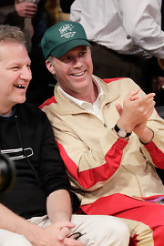 Will Ferrell took in the Lakers game wearing a green baseball cap.