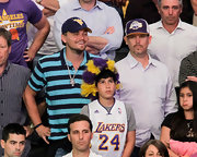 Leonardo DiCaprio stood out at the Lakers game in a boldly striped blue and black polo shirt.