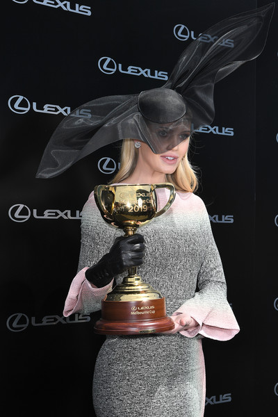 Kitty Spencer wore a black leather glove while holding the Melbourne Cup trophy.
