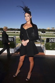 Megan Gale finished off her ensemble with a pair of bow-adorned metallic peep-toes.