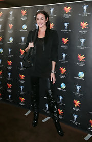 Megan Gale was formal up top and edgy down below with this tux and thigh-high boots combo at the Australian Open cocktail party.