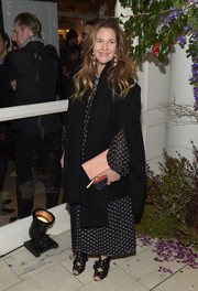 Drew Barrymore sported a black coat and printed maxi dress combo at the Club Monaco presentation.