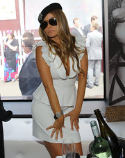 Carmen showed off her silver bangle bracelet which she paired with a classic white skirt suit.