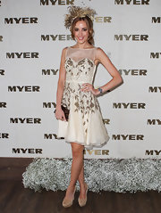 Rebecca Judd wore a heavily embroidered ivory cocktail dress with a sheer neck yoke and a sweetheart bodice.
