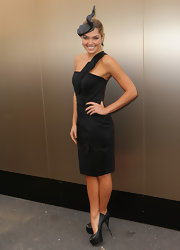 Ashley Hart looked stunning wearing a black dress with a front ruffle detail.