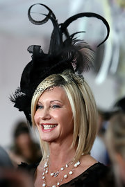 Olivia Newton-John looked like royalty wearing a gorgeous decorative hat at the 2009 Emirates Melbourne Cup