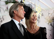 Olivia Newton-John styled her 2009 Emirates Melbourne Cup look with layered chains and a pearl necklace.