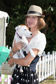 Trinny Woodall accessorized with a gold straw fedora during Macmillan Dog Day.