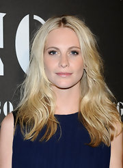 Poppy Delevigne showed off her long blonde curls while hitting the Mango premiere in Madrid.
