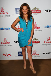 Rachael wore a draped aqua dress with nude platform pumps and a long statement necklace.