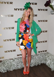 Jennifer Hawkins wore a graphic floral print frock with a faux-wrap tulip skirt for Melbourne Cup Day.