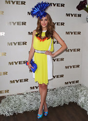 Rebecca Judd went color-blocking in a yellow and white draped cocktail dress for Melbourne Cup Day.