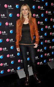 Kira Miro topped off her biker chic look with a pair of brown ankle boots. She gave the biker look a modern twist with a brown leather jacket and boots, different from the all black look we normally see.
