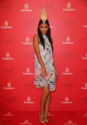 A pink leather clutch with a studded hand strap finished off Chanel Iman's ensemble.