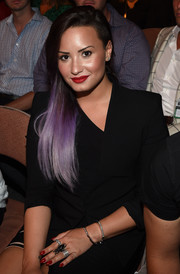 Demi Lovato caught eyes with her huge insect ring at the UFC 175 event.