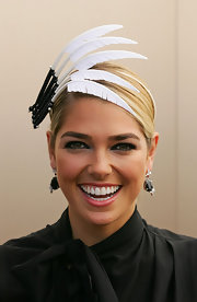 Ashley Hart wore a statement headband with feather-like detail fit for the Victoria Derby Day.