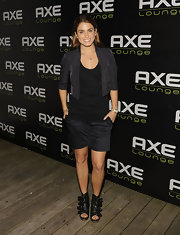Nikki opted for a Navy short suit with multi-buckled, leather, peep toe ankle booties.