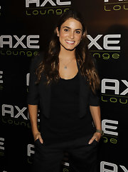 Nikki Reed paired her dress shorts and cropped jacket with long brunette curls.
