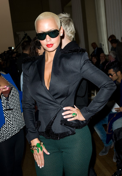 Amber Rose rocked a edgy pair of designer shield shades while attending London Fashion week.