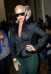 Amber Rose paired her bold blazer with a cool emerald green charm bracelet.