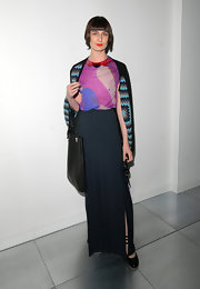 British model Erin O'Connor arrived at London Fashion Week Spring/Summer 2012 wearing a black maxi skirt with a side slit.