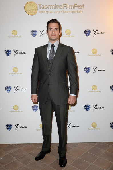 Henry Cavill looked dapper as ever in this charcoal, three-piece suit.