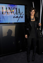 Valeria donned square-toe knee high boots. The black boots looked sleek paired with black leggings and a matching tunic.