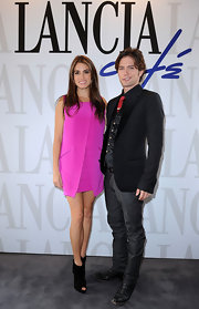 Nikki Reed donned a hot pink frock with black peep-toe ankle booties at the Lancia Cafe in Italy.