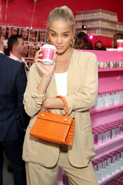 Jasmine Sanders attended the launch of Beautyblender Bounce Liquid Whip Foundation carrying a chic camel-colored crocodile purse.
