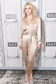 Rhea Seehorn was casual-chic in a belted satin jumpsuit while visiting Build.