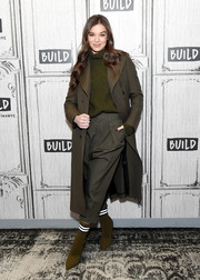 Underneath her coat, Hailee Steinfeld wore baggy capris and a forest-green turtleneck.