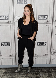 Debby Ryan brightened up her black look with a pair of silver ankle boots.