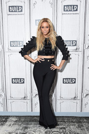 Tyra Banks matched her top with high-waisted flare pants.