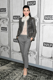 Julianna Margulies paired gray trousers with a pussybow blouse for her visit to Build.