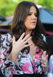 While visiting the TV show Extra, Khloe showed off her mushroom colored nail polish.