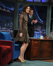 Keira Knightley teamed her feathered Valentino frock with nude and praline patent Dixie pumps.