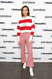 Zoey Deutch played with patterns, teaming her striped sweater with gingham bell-bottoms.