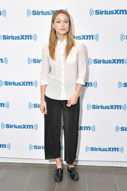 For her footwear, Melissa Benoist chose a pair of black patent loafers.