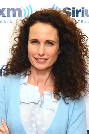 Andie MacDowell wore her hair in voluminous natural curls while visitin SiriusXM Studios.
