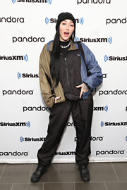 Noah Cyrus was sporty in a tricolor zip-up jacket while visiting SiriusXM.