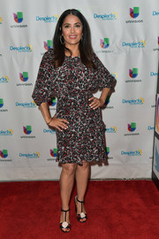 Salma Hayek visited 'Despierta America' wearing a Saloni print dress with a cinched-in waist.