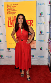 Salma Hayek appeared on 'Despierta America' wearing a sleeveless red shirtdress by Michael Kors.