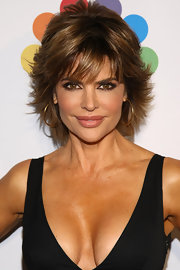 Lisa Rinna wore her cool razored cut with eye-enhancing bangs and lots of volume at 'The Celebrity Apprentice' season four finale.