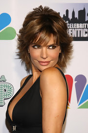 Lisa Rinna batted her lashes in flirty style at 'The Celebrity Apprentice' season four finale. She also used plenty of black eye liner for a super smoky effect.