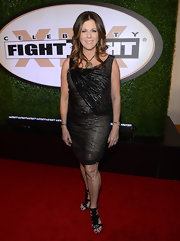 Rita Wilson chose a modern LBD with metallic overlay for her look at the Celebrity Fight Night red carpet.