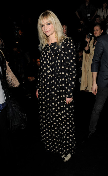Snapped front row at the BFC show during London Fashion Week, Jo Wood looked lovely in this flowing floor-length star print dress.