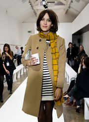 Alexa donned a striped mustard scarf over a wool camel coat for the Margaret Howell fashion show.