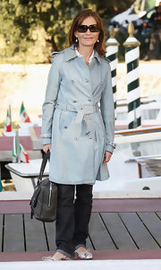 Isabelle Huppert looked smart and classic at the Venice Film Festival in her pastel blue trenchcoat.