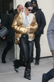 Kendall Jenner was impossible to miss in her futuristic gold Ports 1961 puffer jacket while out and about during Paris Fashion Week.