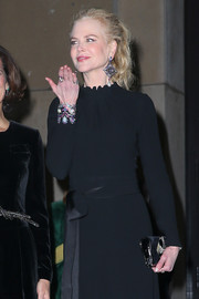 Nicole Kidman accessorized with a stunning gemstone cuff bracelet and matching earrings by Lydia Courteille during Paris Fashion Week.